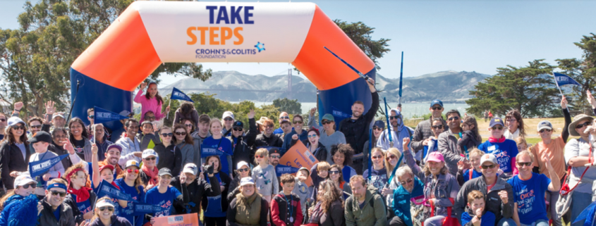 A crowd of people at the finish line of the Take Steps walk